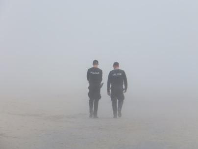 police-fog-seaside-38442.jpeg