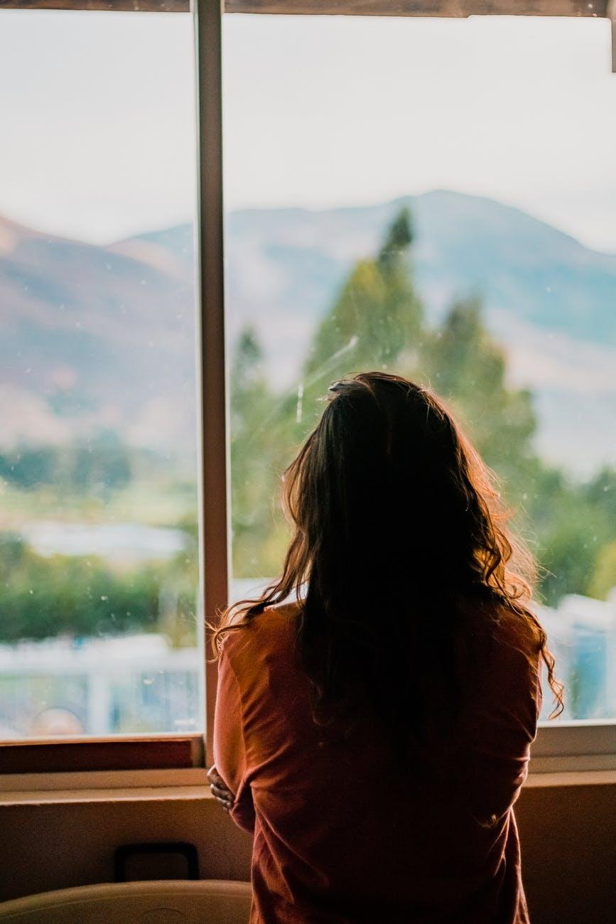 woman wearing brown shirt inside room
